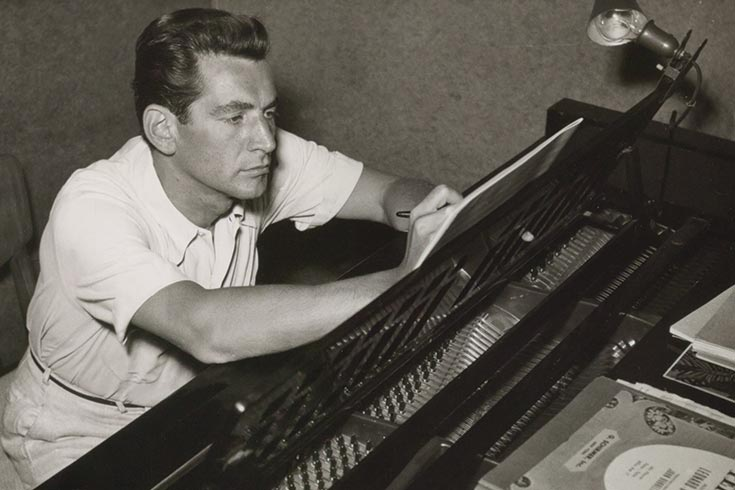 Bernstein writing at piano