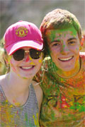Smiling brandeis students covered in paint during the Indian celebration of Holi